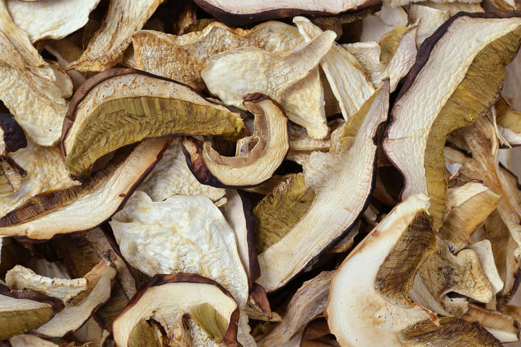 Dried porcini mushrooms background Autumn Boletus Edulis Mushrooms Natural Nature Porcini Vegetarian Background Close Up Dried Edible  Food Fresh Fungus Health Healthy Macro Nutrition Organic Sliced Summer Texture Vegan Vegetable Wild