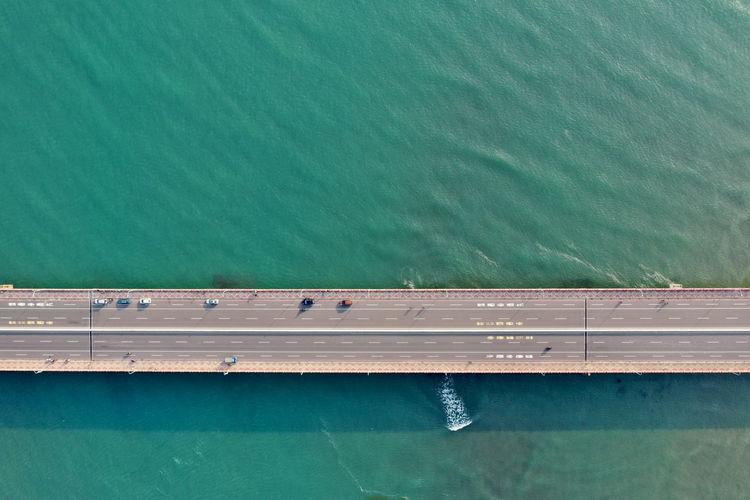 Aerial view of bridge over seascape
