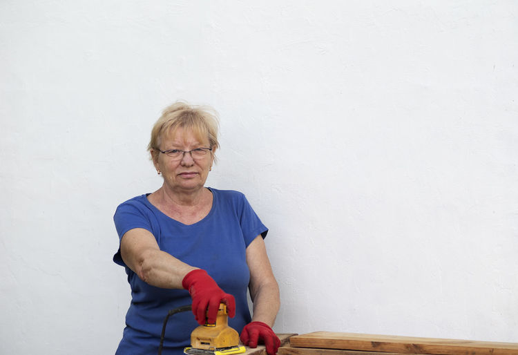 Full length of woman on table against wall