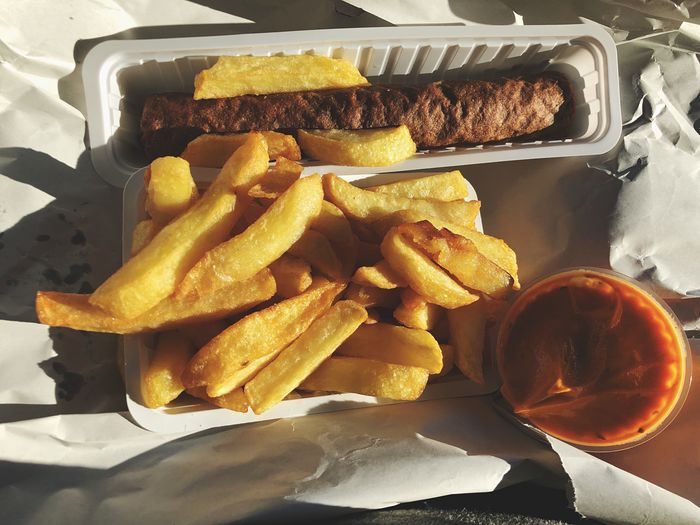 Belgium food Frikandel and Belgium Fries with sauce Andalouse Sauce Frikandel Belgium Fries Fries Fries Summer Sunlight Food Food And Drink Freshness Still Life Prepared Potato Indoors  Potato Ready-to-eat High Angle View French Fries Close-up Unhealthy Eating Fried Fast Food Snack Eating Utensil