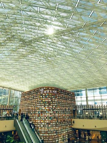 Seoul, Korea Seoul ShotOnIphone Starfield Library Books Library Modern Architecture Glass Roof Architecture Built Structure Day Indoors  Water Large Group Of Objects No People Glass - Material Travel High Angle View Mode Of Transportation Abundance Lifestyles Ceiling Transparent