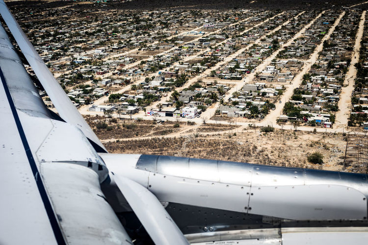 Aerial Photography Aerial Shot Aerial View Aircraft Wing Airplane Airport Runway Commercial Airplane Lines And Shapes Shanty Town Travel