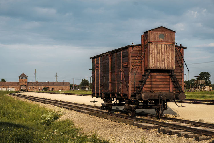 Auschwitz-Birkenau Nazi Concentration Camp Auschwitz  Birkenau Holocaust Remembrance Architecture Auschwitz Birkenau Cloud - Sky Day Freight Transportation Holocaust Holocaust Memorial Mode Of Transport No People Outdoors Rail Transportation Railroad Track Sky Train - Vehicle Transportation