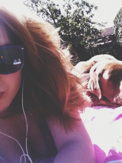 Sun bathing with the dog