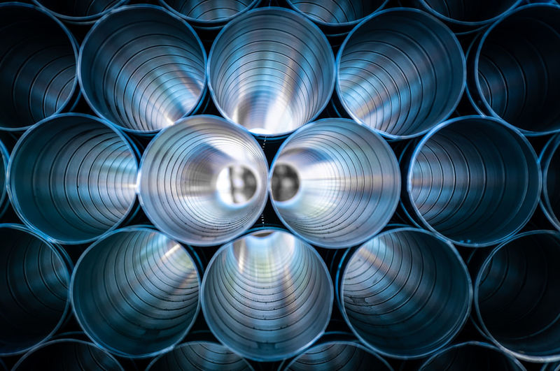 Construction Industry Reflection Tube Abstract Abundance Alloy Aluminum Backgrounds Blue Business Finance And Industry Circle Close-up Design Equipment Factory Full Frame Geometric Shape Indoors  Industry Large Group Of Objects Manufacturing Equipment Metal Metal Industry No People Pattern Pipe - Tube Pipes Shape Stack Steel Technology Textured  Tubes The Still Life Photographer - 2018 EyeEm Awards 10 Humanity Meets Technology