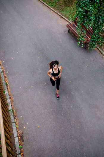 High angle view of woman running on street