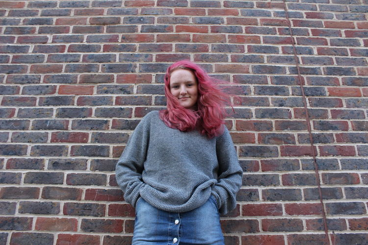 Photo 11 Fashion/Editorial work for college. Adults Only Brick Wall Cardigan Sweater Casual Clothing Fashion Front View Hair Long Hair Long Sleeved Looking At Camera One Person One Woman Only Only Women Outdoors Photography Pink Portrait Real People Smiling Standing Sweater Warm Clothing Women Young Adult Young Women Women Around The World EyeEmNewHere