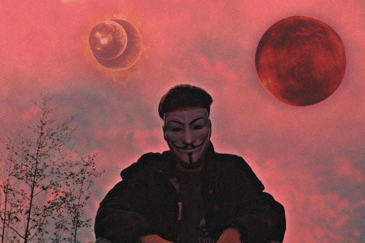 Portrait of man standing against orange sky
