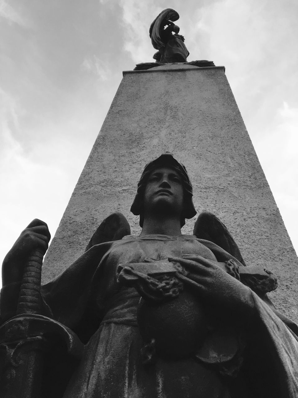 statue, low angle view, human representation, sculpture, male likeness, art and craft, creativity, female likeness, history, craft, sky, cloud - sky, outdoors, day, travel destinations, built structure, architecture, monument, no people, building exterior