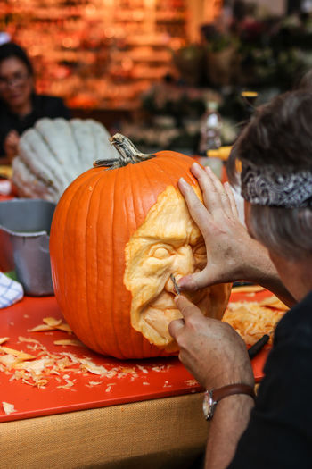 Man carving pumpkin