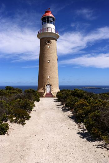 The lighthouse at Cape du Couedic, Kangaroo Island, South Australia, established in 1909 Sky Direction Lighthouse Built Structure Protection Architecture Tower Building Exterior Guidance Cloud - Sky Security Sea Safety Building Nature Water Outdoors Plant Australian Landscape Travel Photography Maritime Safety Warning No People Horizon Over Water Scenic Landscapes