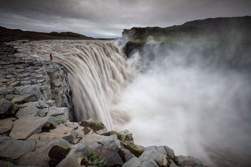 Dettifoss is the most powerful waterfall in Europe ,Iceland summer. Dramatic Sky Rainy Days Beauty In Nature Close-up Dettifoss Dramatic Flowing Flowing Water Long Exposure Motion Nature Outdoors Power Power In Nature Real People Scenics - Nature Sky Water Waterfall