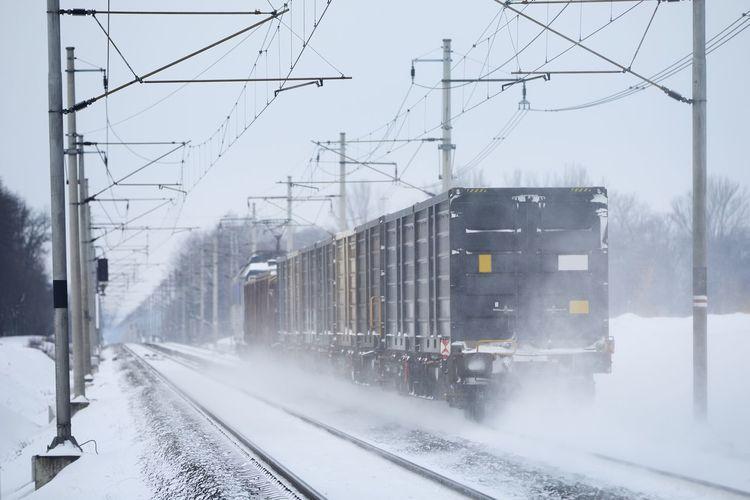 Train on railroad tracks in winter