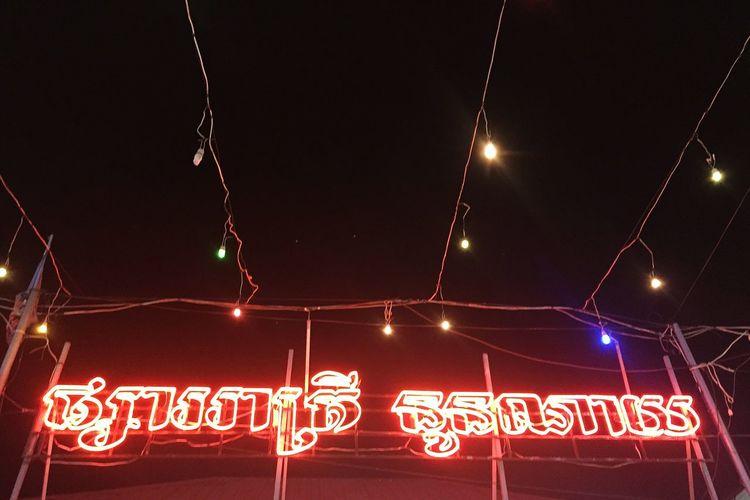 Night market. Cambodian Tourism Market Night Market Wanderlust Tourist Destination Neon Illuminated Red Celebration Text Communication Lighting Equipment Sky Famous Place Typescript