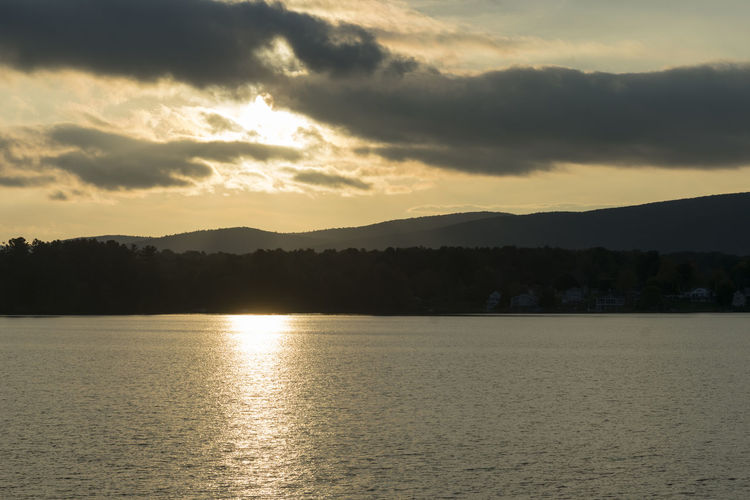 More photos from my first DSLR session in 2018. Captured during the summer months in the Berkshires, MA. Gorgeous place to be. Sky Sunset Water Beauty In Nature Cloud - Sky Scenics - Nature Tranquility Tranquil Scene Waterfront No People Nature Mountain Idyllic Sea Reflection Sunlight Silhouette Non-urban Scene Outdoors Kevin Giambertone EyeEmNewHere