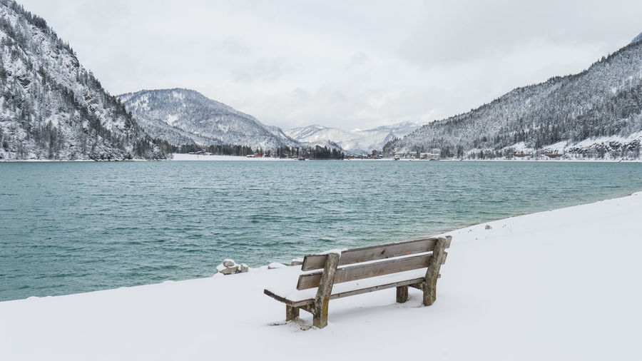 Achensee Austria Bench Cloudy Lonely Romantic Tirol  Beauty In Nature Cold Temperature Day Lake Lake View Lakeshore Mountain Mountain Range Nature No People Outdoors Scenics Silence Silent Moment Snow Tranquility Water Winter EyeEmNewHere