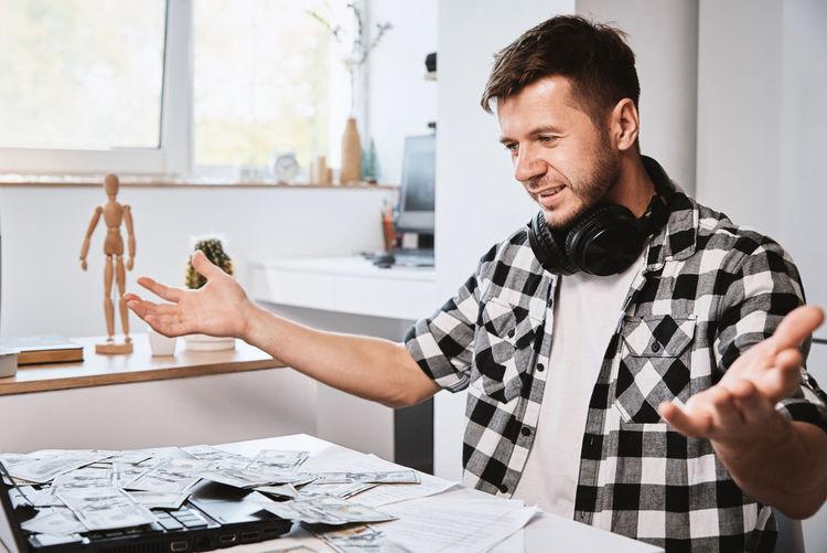 Man enjoy to many dollar banknotes