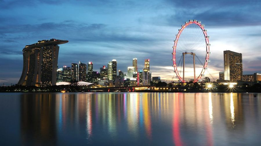 colors and reflections. Skyline Skyscraper Cityscape Urban Skyline Architecture Night Illuminated City Modern Outdoors Reflection Colors Sunset Photography Landscape Ferris Wheel Singapore Flyer Marina Bay Sands CBD Singapore First Eyeem Photo