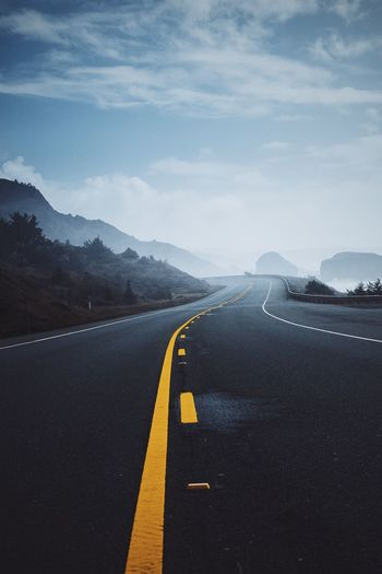 Open road inviting all of you Road Marking Road The Way Forward Empty Diminishing Perspective Sky Vanishing Point Mountain Tranquil Scene Travel Destinations Tranquility Oregon Coast Highway Asphalt Open Road Foggy Landscape In The Mist My Year My View An Eye For Travel