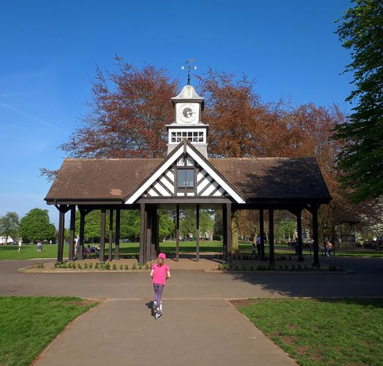 sunny day fun at Page Park Pagepark Parklife Staplehill Victorianpark Igersbristol Bristol Bristol247 Visitbristol Bestofbristol Igerssouthglos Southglos Capturingbritain_urban Englandsbigpicture Bristol_vue Swisbest Livebristol Park Scooter Scooting Clock Tower Victorian This Is Family City Full Length Bicycle Tree Childhood Cycling Sky