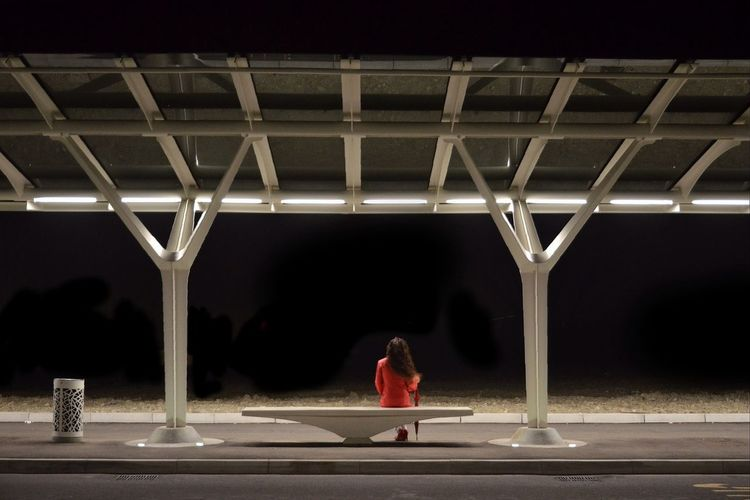 Rear view of woman standing at night