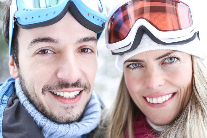 portrait of a smiling young couple Active Adult Couple Couple - Relationship Cross-Country Skiing Emotion Face Front View Fun Happy Headshot Holiday Human Face Leisure Leisure Activity Lifestyle Looking At Camera Man Men Mid Adult Outdoors Outside People Portrait Positive Emotion Real People Scarf Ski Ski Goggles Ski Holiday Ski Trip Skier Skiing Smile Smiling Snow Sport Togetherness Two People Winter Winter Holiday Winter Sports Woman Women Young Adult Young Men Young Women