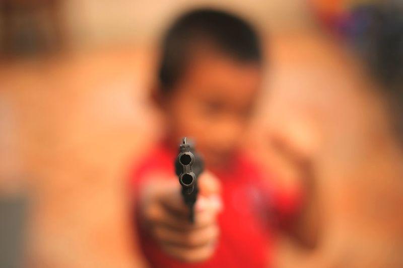 kids pointing toy gun Human Hand Weapon Close-up Handgun Pistol Self-defense Terrorism Ammunition Aiming Gun Target Shooting Rifle Shooting A Weapon