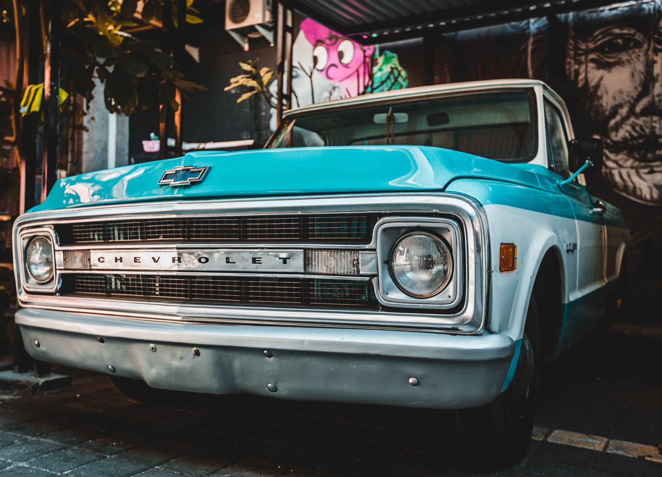 retro styled, car, land vehicle, mode of transportation, motor vehicle, vintage car, transportation, headlight, day, old, no people, stationary, focus on foreground, vintage, city, outdoors, front view, street, metal, silver colored
