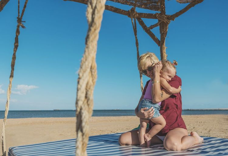 Mother Babygirl Baby Kid Girl Girlfriend Beach Sea Sand Water Summer Vacations Outdoors Day Sky Two People Blue Sunny Horizon Over Water Nature Childhood Friendship Happiness People Child Togetherness This Is Family