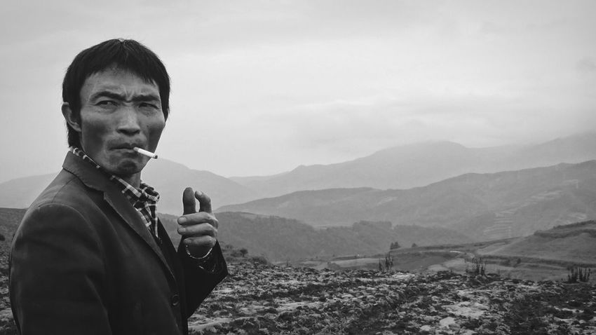 The owner of the guest house, we stayed in in the red lands, drove us to the perfect viewpoints for photos. Unfortunately the weather wasn't on our side, so i preferred to give my shots another focus. He kind of reminds me of Bruce Lee... hm China Authentic Moments Capture The Moment Blackandwhite B&W Portrait Places And People Landscape_Collection Black And White Portrait Travel Weather Culture Resist