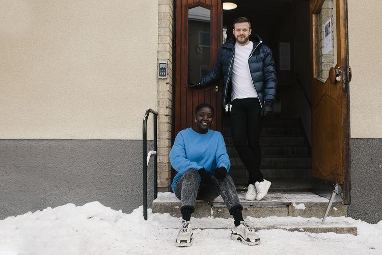 Portrait of people walking in snow