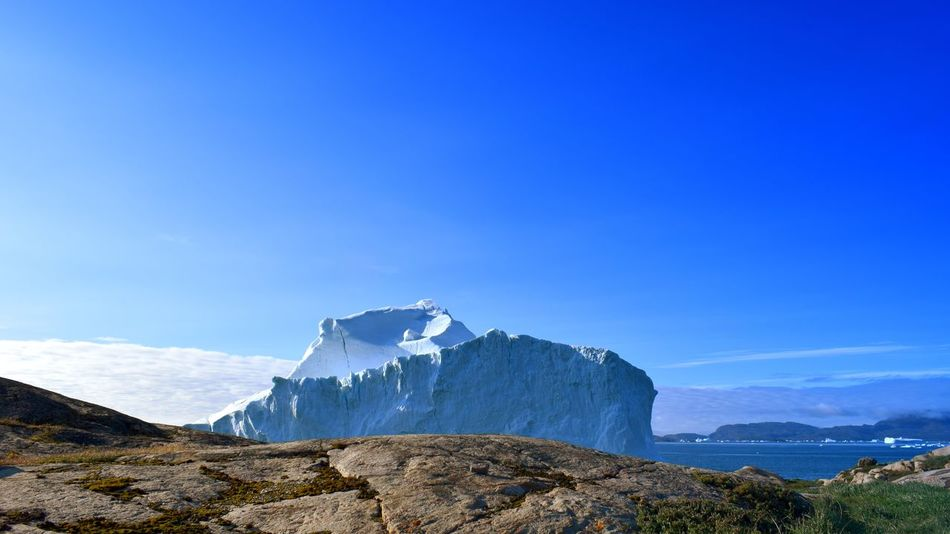 Another iceberg near our village Innaarsuit. Greenland Travel Destinations Innaarsuit Summer Village Nature Perfectweather EyeEm Selects Mountain Snow Mountain Peak Blue Sky Mountain Range Landscape Cloud - Sky Physical Geography Iceberg Natural Landmark