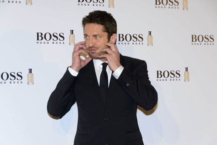 "The Scottish actor and producer, Gerard Butler, attended the Cocktail Hugo Boss photocall as ""Man of Today"" and Ambassador of Boss Bottled fragrances in Madrid, Spain. Actor Boss Bottled British Celeb Celebrity Editorial  Event Fashion Film Star Fragrance Front View Gerard Butler Hugo Boss Man Of Today Men Photocall Portrait Red Carpet Scottish Standing Standing Vip Waist Up Young Adult Young Men"