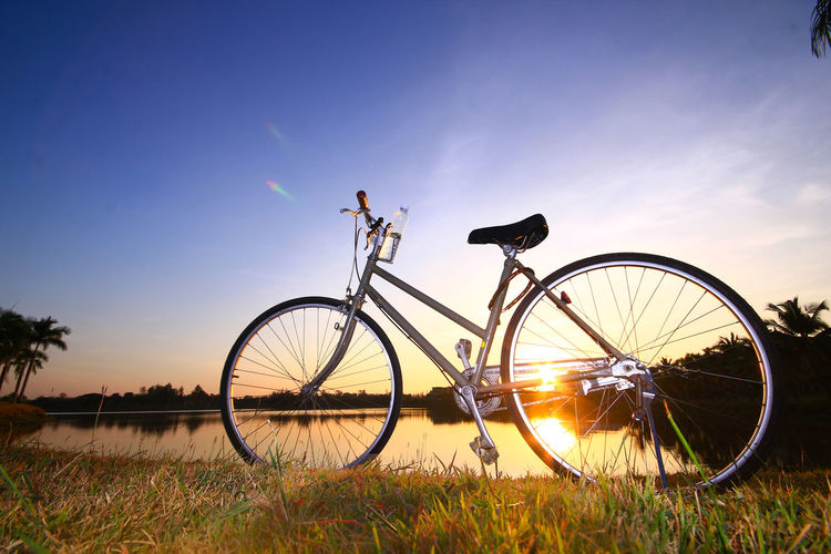 Nature relaxing from bike evening time Bicycle Cycling Silhouette Nature Sunset Sky Outdoors Vacations Night Sport Scenics Headwear Leisure Activity Adventure People Water One Person