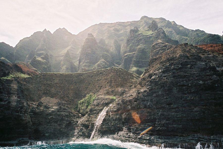 Na Pali Analogue Photography Hawaii Ishootfilm Kauai Na Pali Coast Beauty In Nature Coast Day Film Photography Filmisnotdead Filmphotography Landscape Mountain Mountain Range Nature No People Outdoors Scenery Scenics Sky Tranquil Scene Tranquility Water EyeEmNewHere The Great Outdoors - 2018 EyeEm Awards