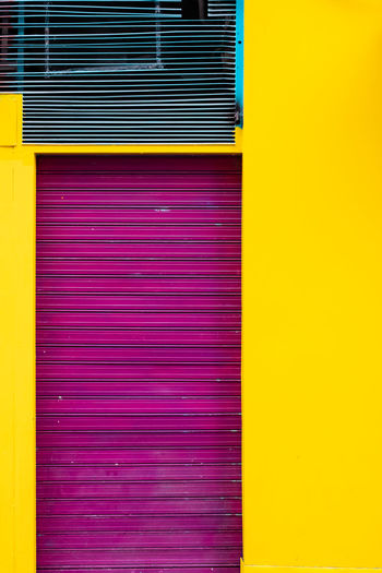Minimalist Minimalist Architecture The Week on EyeEm Architecture Backgrounds Built Structure Closed Corrugated Corrugated Iron Day Full Frame Iron Metal Minimal Multi Colored No People Pattern Pink Color Purple Red Shutter Textured  Vibrant Color Wall - Building Feature Yellow