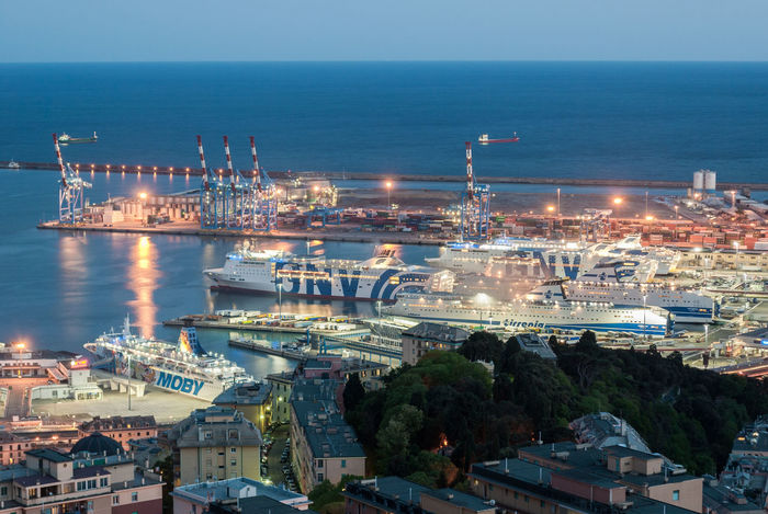 Ferries moored at the harbor of Genoa in the evening Blue Hour City Cityscape Ferry Ferryboat Genoa Genova Harbor Mediterranean  Skyline Transportation Twilight Aerial Aerial View Boats Evening Industry Italy Liguria Long Exposure Night Outdoors Sea Ships Urban
