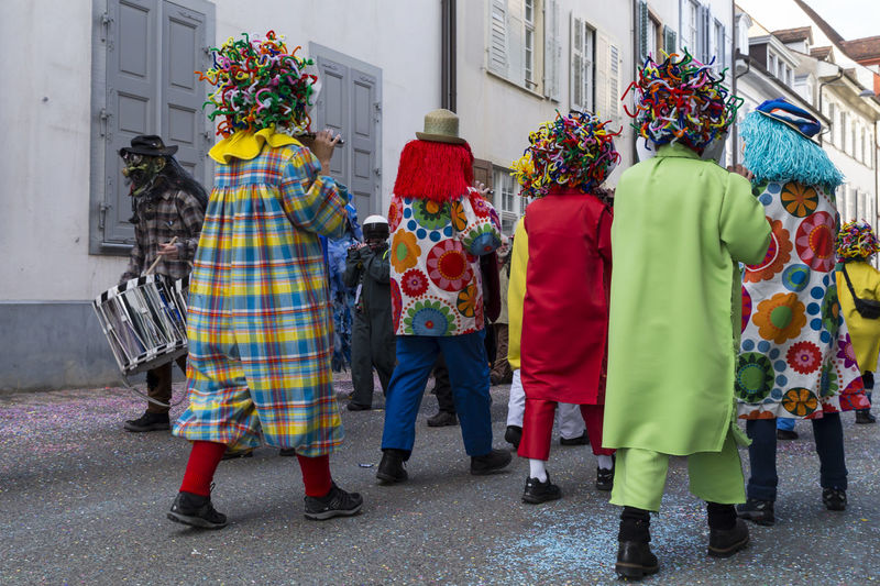 Nadelberg, Basel, Switzerland - March 7, 2017. A group of carnival participants playing piccolo. Picture taken from behind. Basel Carnival Carnival Crowds And Details City Creativity Event Tourist Attraction  Tradition Candid Colorful Confetti Costume Fasnacht Festival Group Of People Marching Mask - Disguise Outdoors Piccolo Real People Shrove Tuesday Snare Drum Streetphotography Swiss Switzerland