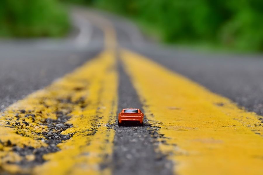 EyeEm Selects Yellow Transportation Road Selective Focus Day No People Outdoors Mode Of Transportation Diminishing Perspective City Close-up The Way Forward Road Marking Marking Sign Street Direction Asphalt Nature Land Vehicle The Still Life Photographer - 2018 EyeEm Awards The Still Life Photographer - 2018 EyeEm Awards