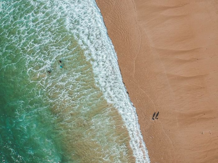 Waves meets the sand. Wave Water Day Sea High Angle View Beach Nature No People Land Sand Sunlight Outdoors Beauty In Nature Wave Directly Above Backgrounds