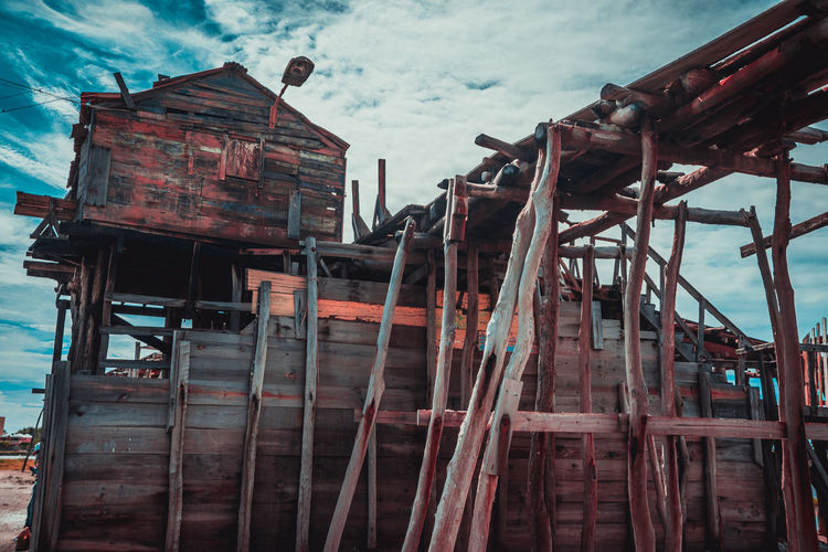 Low angle view of old construction on salt mine against sky