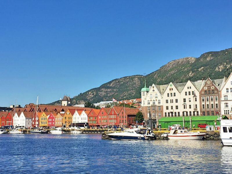 Bryggen Building Exterior Architecture Clear Sky Mountain Sea Outdoors Waterfront Harbor Sailboat Day