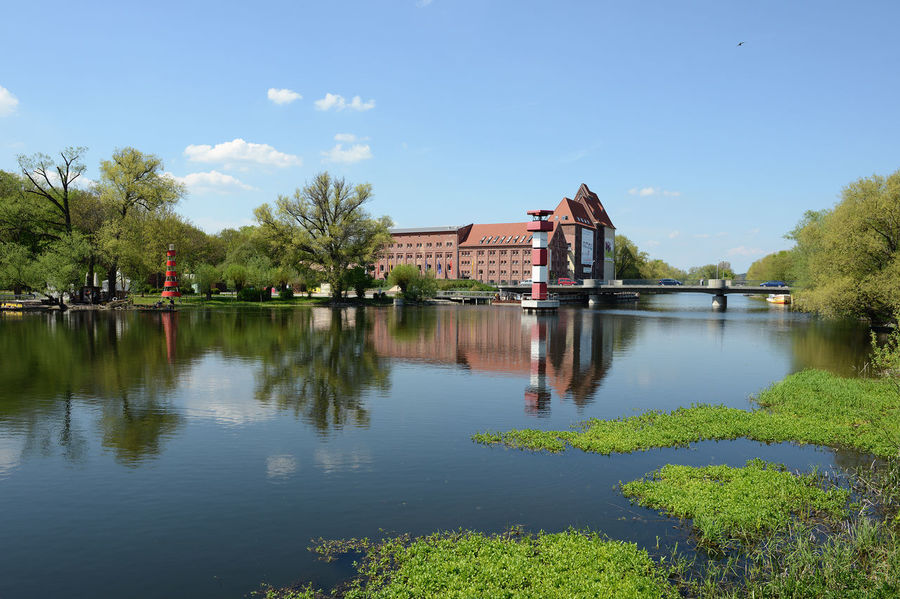 Cityscape of Rathenow (Brandenburg Germany) and Havel river with historical mill Brandenburg Cityscape German Havel River Havelland Germany Rathenow Architecture Built Structure Day Havel Havelland Look Reflection Travel Destinations Urban Water