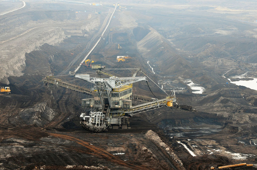 aerial view in coal mine with bucket wheel excavator. destruction of nature. fossil energy. Industry Mining High Angle View Fuel And Power Generation Coal Mine Quarry Coal Outdoors Transportation Tagebau Braunkohle Braunkohletagebau Fossil Energy Bucket Wheel Excavator Schaufelradbagger Mountain Mode Of Transportation Construction Industry
