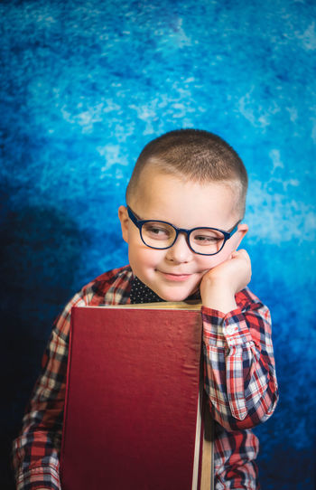 Portrait of boy with book