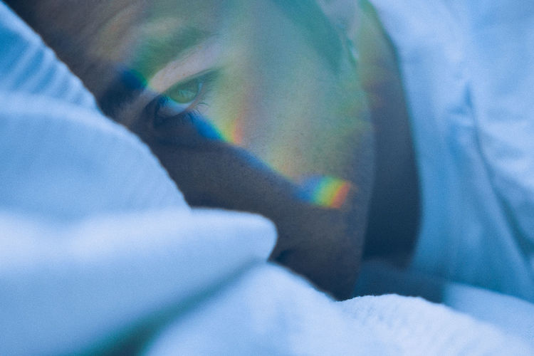 Close-up portrait of man with spectrum on face