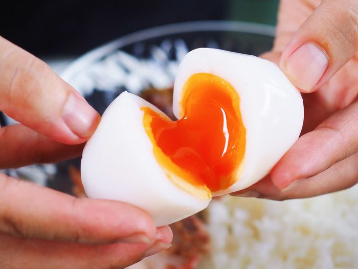 Human Hand Holding Human Body Part Hand Food And Drink Food Real People Freshness One Person Close-up Lifestyles Finger Focus On Foreground Body Part Human Finger Egg Healthy Eating Egg Yolk Unrecognizable Person Preparation  Preparing Food