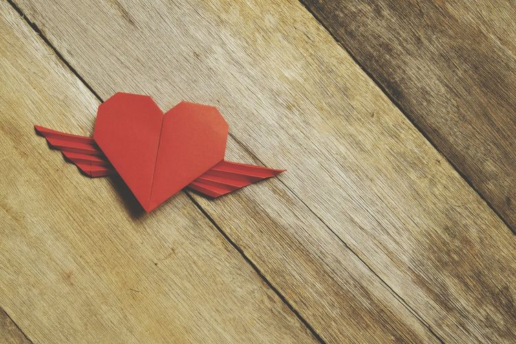 High angle view of red heart shape decoration on table