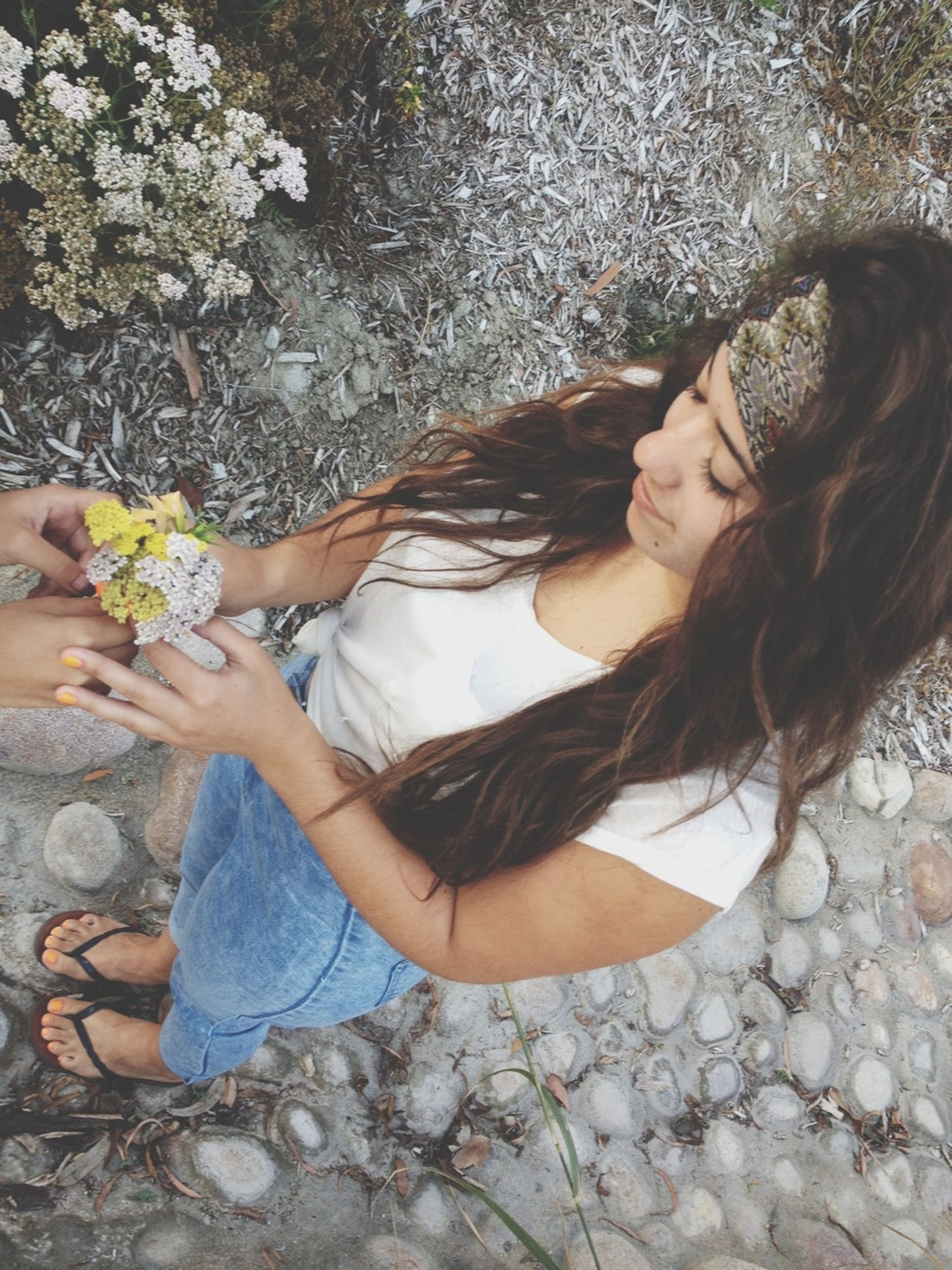 lifestyles, leisure activity, casual clothing, young women, person, young adult, standing, flower, long hair, high angle view, full length, girls, day, nature, water, outdoors, sitting