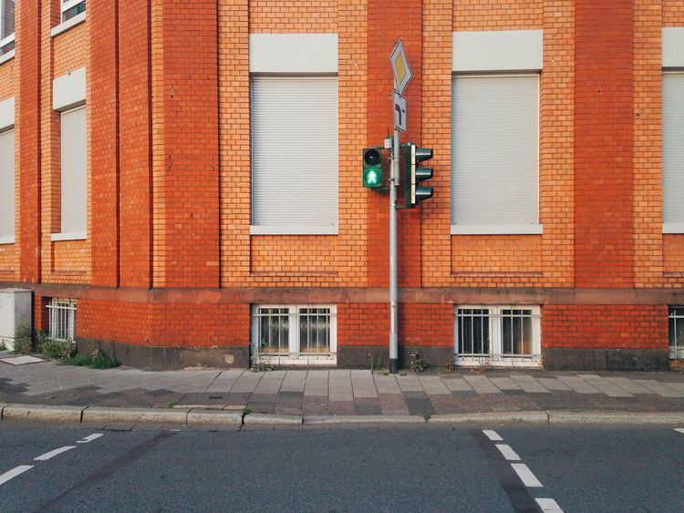 Architecture Building Building Exterior Built Structure City Cityscapes Colorful Communication Europe Green Land Vehicle Minimal Minimalism No People Outdoors Road Road Sign Street Traffic Traffic Lights Walking Up Close Street Photography Fine Art Photography On The Way Embrace Urban Life